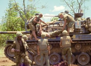 U.S. Marine tank is used to transport dead and wounded Marines from engagement with NVA forces surrounding Con Thien 1967. (Photo by Robert Stokes)