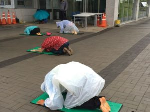 Gangjeong Village activists bowing as part of a daily morning ritual. (Photo by Ann Wright)