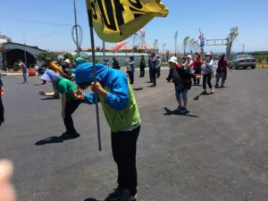 "The noon time ""Human Chain"" at the entrance of the Naval Base at Gangjeong Village, done to remind the South Korean Navy that the opposition to the construction of the naval base has not ended. (Photo by Ann Wright)"