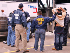 U.S. Immigration and Customs Enforcement (ICE) officers arresting suspects during a raid in 2010. (Photo Courtesy of ICE)