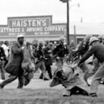 John Lewis, now a U.S. congressman, being attacked during the voting rights march in Selma, Alabama, in 1965.