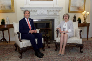 U.S. Secretary of State John Kerry sits with British Prime Minister Theresa May in the White Room No. 10 Downing Street in London, U.K., on July 19, 2016. [State Department Photo]