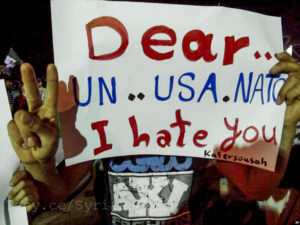 A protest placard in the Kafersousah neighborhood of Damascus, Syria, on Dec. 26, 2012. (Photo credit: Freedom House Flickr)