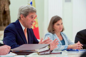 U.S. Secretary of State John Kerry, flanked by Assistant Secretary of State for European and Eurasian Affairs Victoria