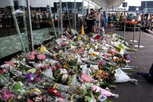 Makeshift memorial at Amsterdam Schiphol Airport for the victims of the Malaysian Airlines flight MH17 which crashed in the Ukraine on 17 July 2014 killing all 298 people on board. (Roman Boed, Wikipedia)