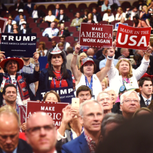Delegates hold signs during Day Two of the Republican National Convention (Photo from convention.gop)