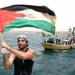 The Palestinian flag is waved as relief ships arrive in Gaza in August 2008.