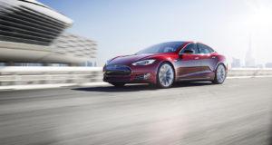 An electric-powered Tesla sedan.
