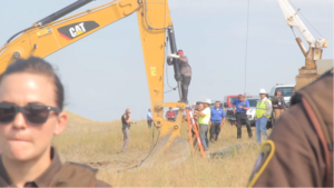 "The #NoDAPL water Protectors took non-violent direct action by locking themselves to construction equipment. This is ""Happy"" American Horse from the Sicangu Nation, hailing from Rosebud. August 31, 2016 (Desiree Kane, Wikipedia)"