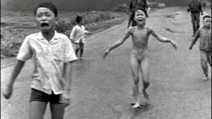 Nick Ut's famous photo of terrified South Vietnamese children fleeing from a napalm attack on the village of Trang Bang in 1972. The girl, Phan Thi Kim Phuc,  has ripped off her burning clothes.