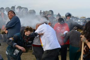 Security forces protecting the Dakota Access pipeline construction spray protesters with pepper spray. (Photo by Tim Yakaitis)