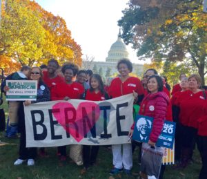 Members of National Nurses United, which organized the anti-TPP event on November 17, 2016, hold a sign supporting Bernie Sanders. (Photo by Chelsea Gilmour)