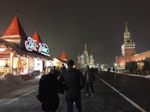 Red Square in Moscow with a winter festival to the left and the Kremlin to the right. (Photo by Robert Parry)