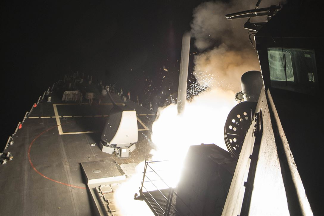 The arleigh burke class guided missile destroyer uss ross fires a tomahawk land attack missile from the mediterranean sea into syria april 7 2017