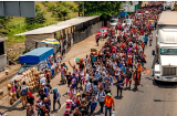 Over-a-thousand-Hondurans-marching-to-ou