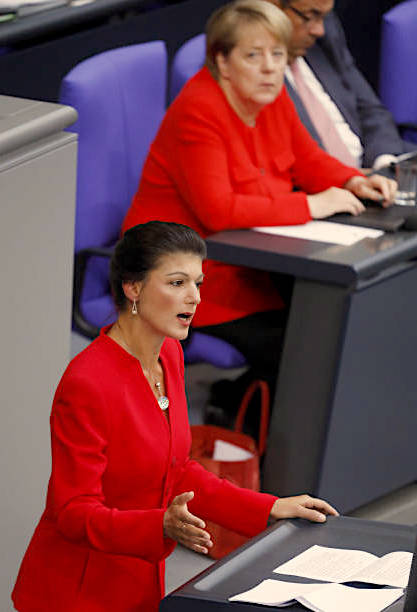 Wagenknecht in the Bundestag with Merkel looking on.  (Photo by Michele Tantussi/Getty Images