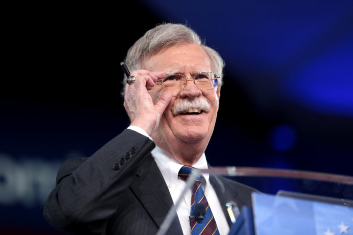 John Bolton adjusting eyeglasses