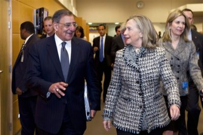 Defense Secretary Leon E. Panetta talks with Secretary of State Hillary Rodham Clinton at NATO Headquarters in Brussels, April 18, 2012. DOD photo by Erin A. Kirk-Cuomo
