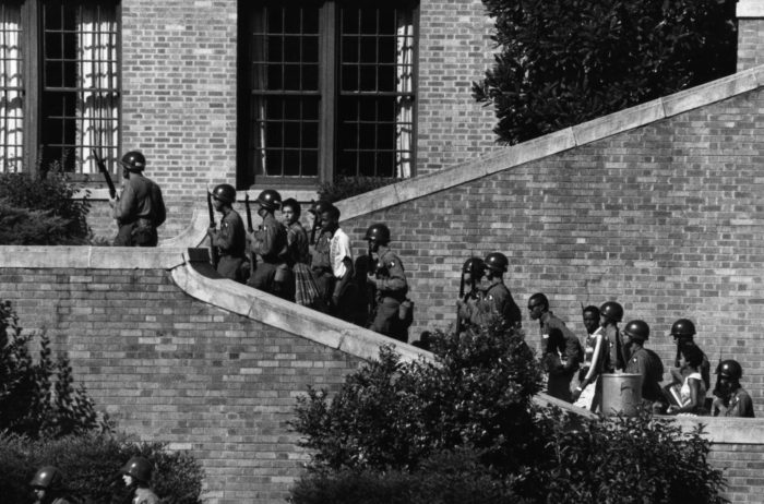 Soldiers from the 101st Airborne Division escort the Little Rock Nine students into the all-white Central High School in Little Rock, Ark., 1957. (Wikimedia)