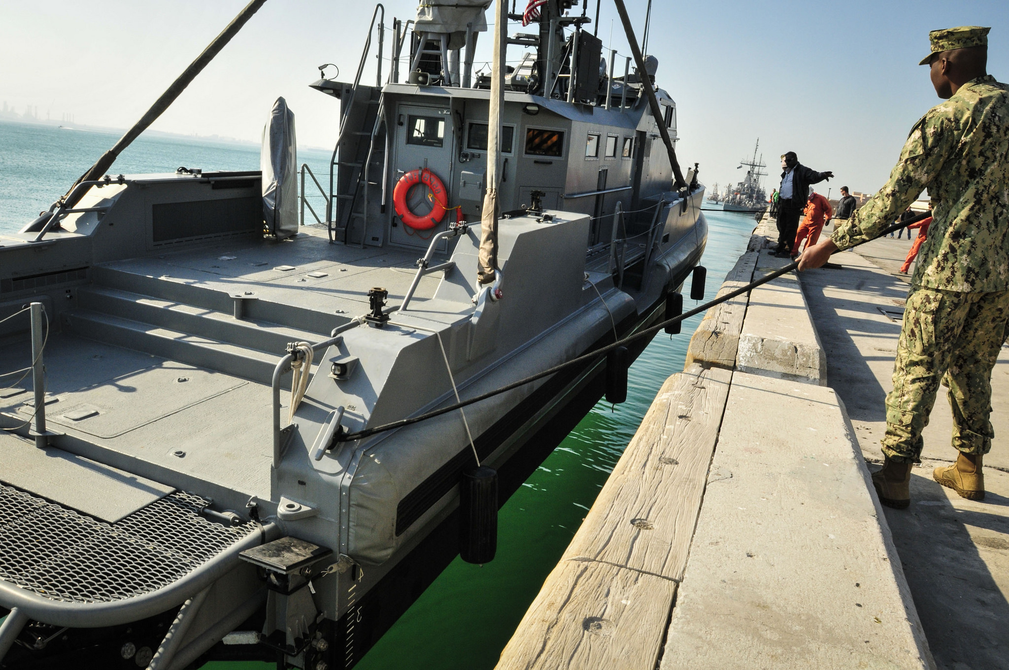 U.S. Navy's Coastal Command Boat lowered into water in its homeport of Bahrain, 2014. (Mass Communication Specialist 1st Class Felicito Rustique)