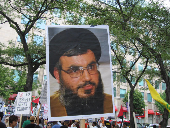 Poster of Hassan Nasrallah in 2006 rally in Toronto against Iraeli aggression/occupation of Palestine and Lebanon. (humbleslave via Flickr)