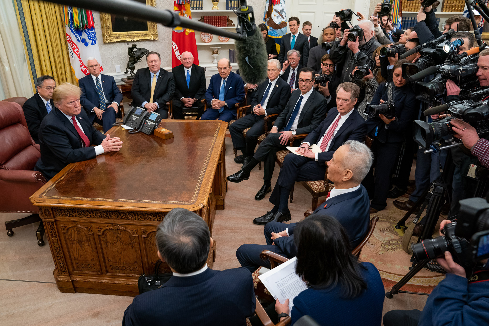 Trump, joined by other U.S. officials, receives Chinese Vice Premier Liu He in Oval Office, January 2019 (Official White House Photo by Tia Dufour via Flickr )