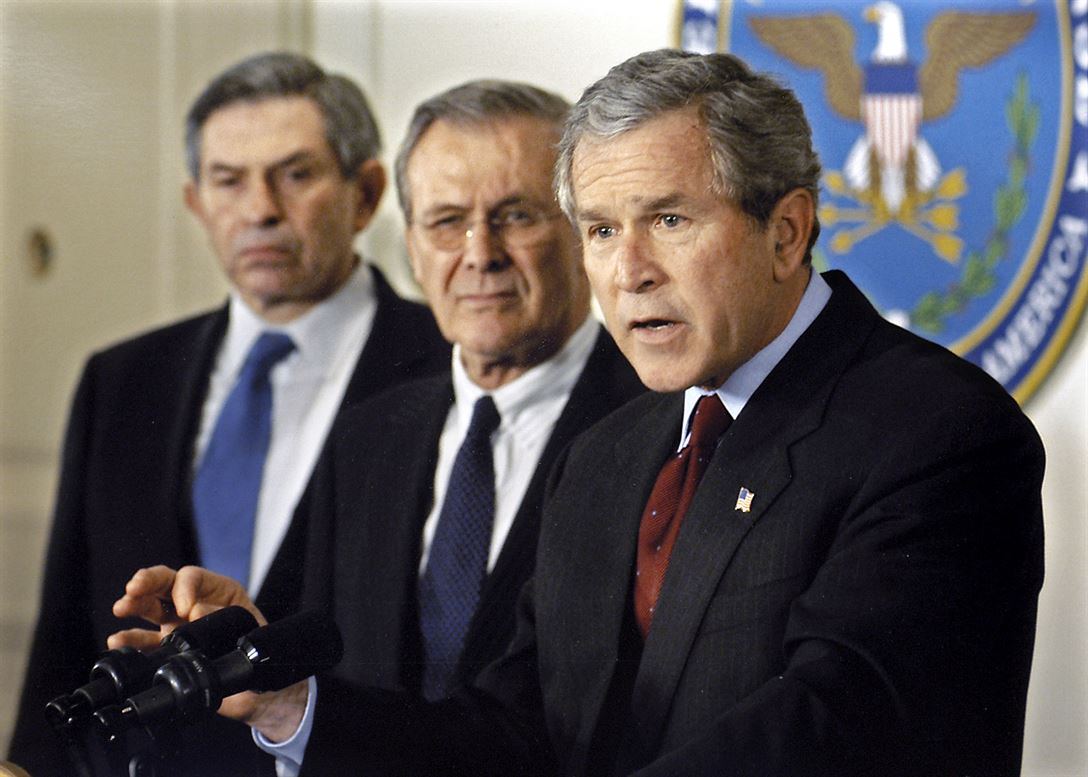 Defense Secretary Donald H. Rumsfeld, middle, Deputy Secretary of Defense Paul Wolfowitz, at left. (Defense Department photographer Robert D. Ward)