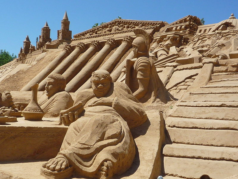 Depiction of ancient Roman decling and falling, 2010, at Seventh International Sand Sculpture Festival. (Wikimedia)