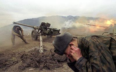 Russian artillery shells Chechen positions near the village of Duba-Yurt, January 2000. (Wikimedia)