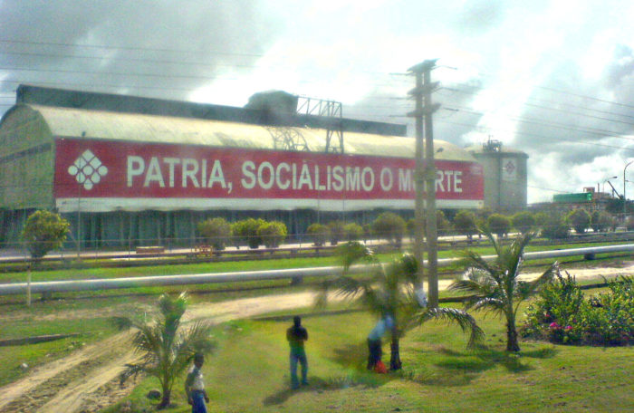 "PDVSA building 2008. ""Fatherland, socialism or death."" (Nicolas Hall via Wikimedia)"