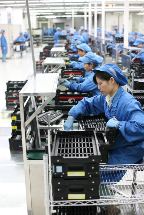 Workers in 2008 perform quality control testing on computer drives; Seagate Wuxi China Factory Tour. (Robert Scoble via Wikimedia)
