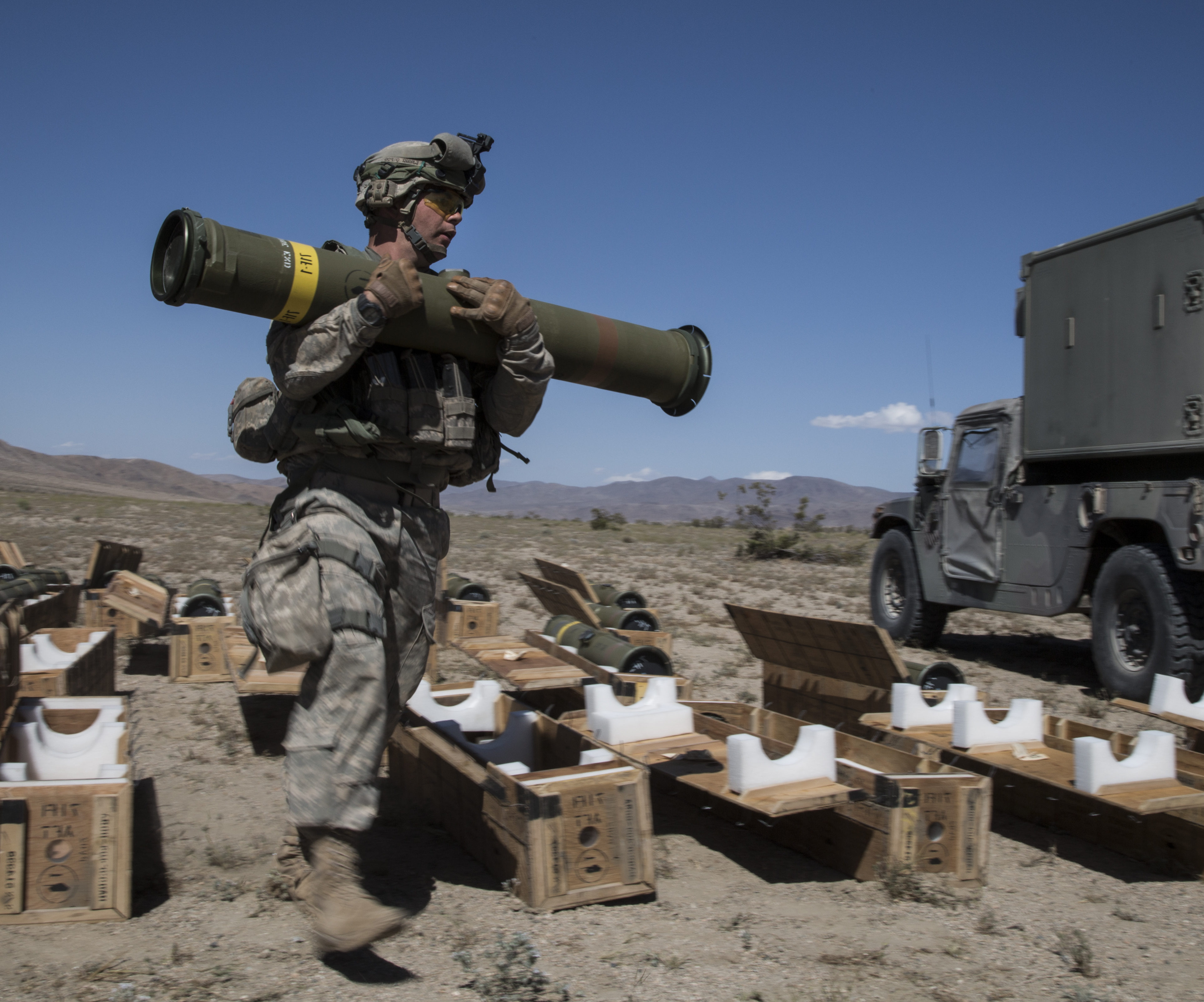 U.S. Army soldier holding a Tube-launched, Optically-tracked, Wire-guided (TOW) 2B Aero Missile at National Training Center, Fort Irwin, 2014. The anti-tank guided missile can hit targets over 4,000 miles away. (U.S. Army photo by Sgt. Richard W. Jones Jr./Released)