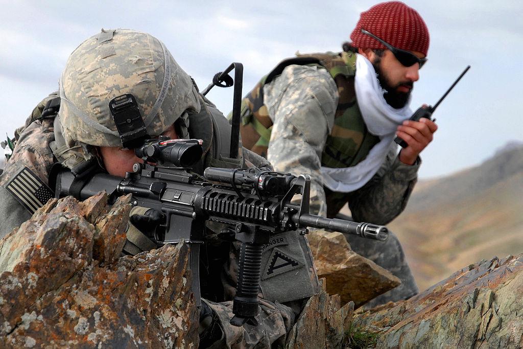 A U.S. soldier and an Afghan interpreter in Zabul, 2009 (DoD photo by Staff Sgt. Adam Mancini)