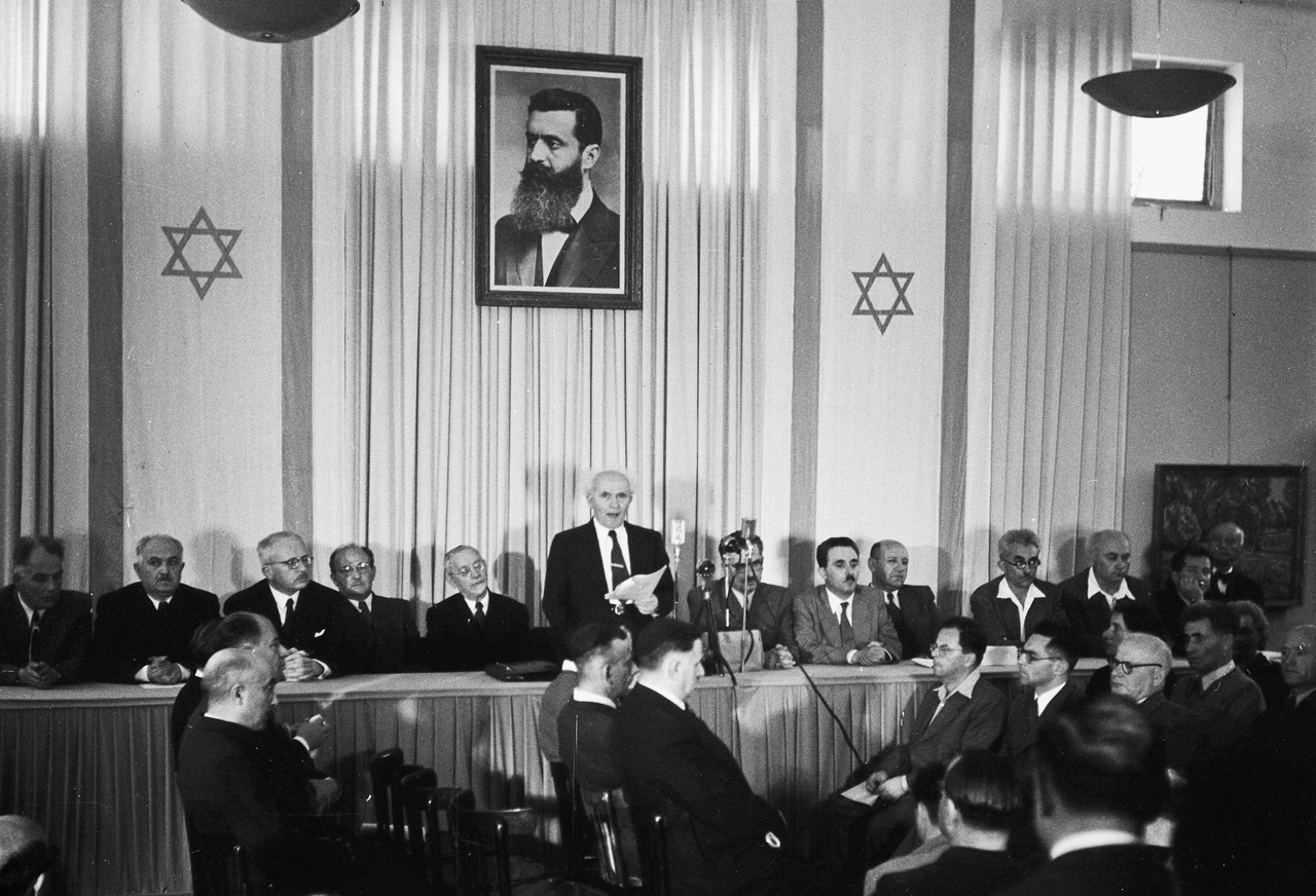 David Ben-Gurion publicly pronouncing the Declaration of the State of Israel, May 14 1948, Tel Aviv, Israel. (Wikimedia)
