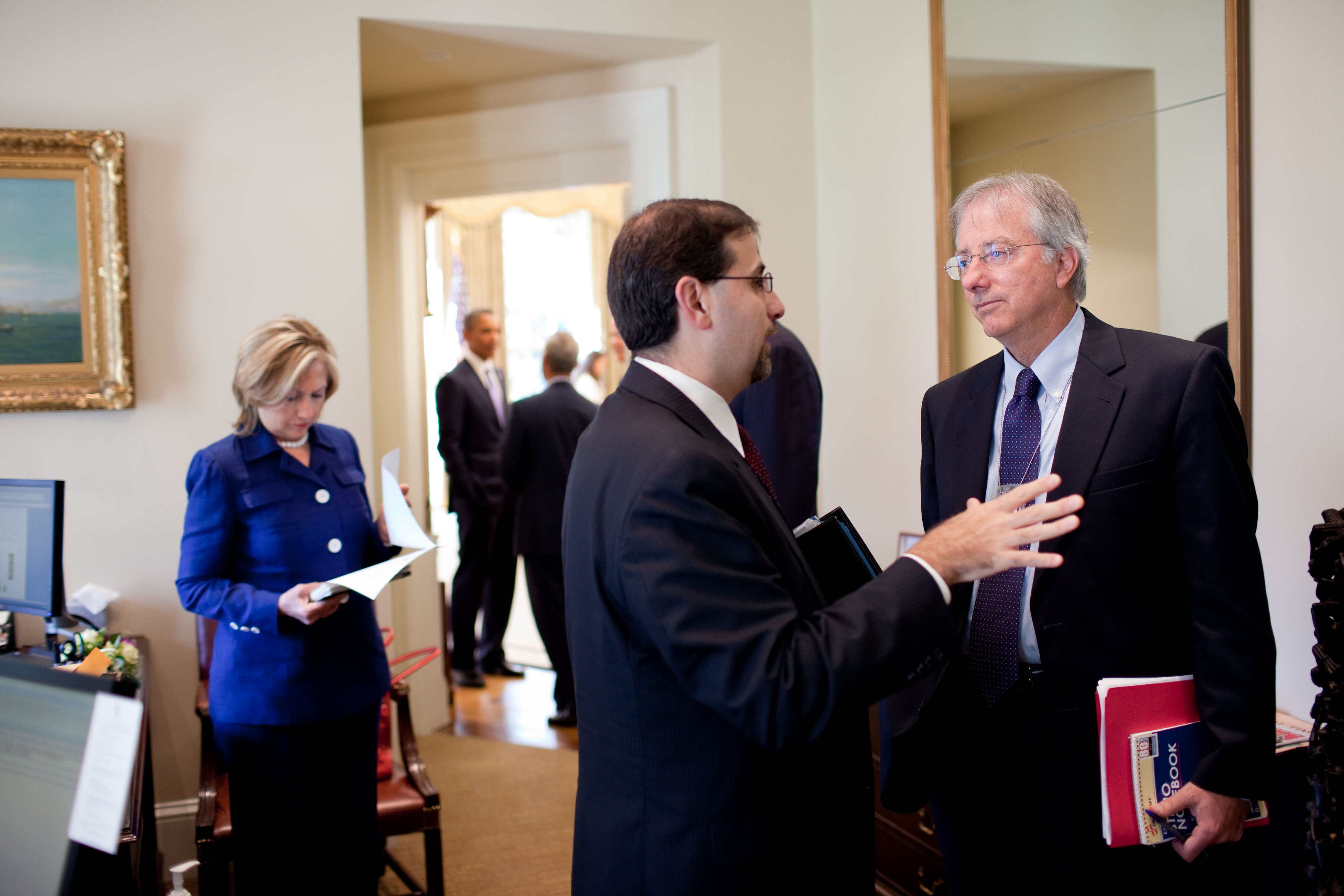 Dennis Ross, at right, with Dan Shapiro, NSC senior director for the Middle East, Oval Office. Secretary of State Hillary Clinton at left. (White House/Pete Souza)