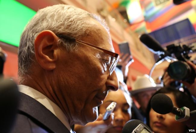 John Podesta at the spin room of the second presidential debate of 2016. (Voice of America via Wikimedia Commons)