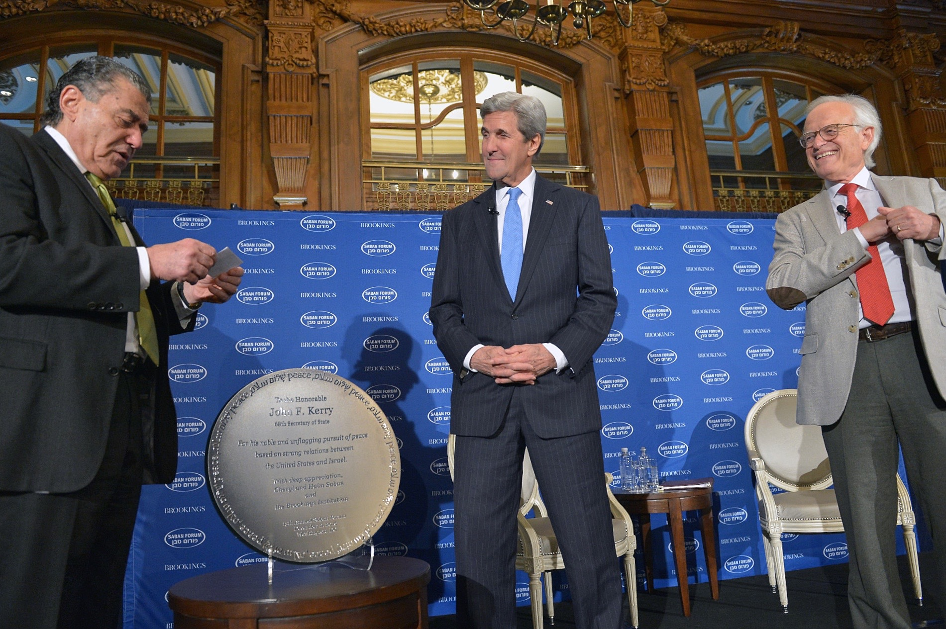 Saban presents U.S. Secretary of State John Kerry with an award at Brooking Institution's 2016 Saban Forum. (State Department via Wikimedia Commons)