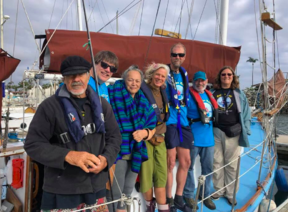 "Left-right: Captain Lappala; alternate crewmember Chris Mayer; Hawaii elder Puna Kalama Dawson; crewmember ""Che"" Burton; crewmember Jamie Skinner; First Mate Tom Rogers; Golden Rule operations manager Helen Jaccard. (Ann Wright)"