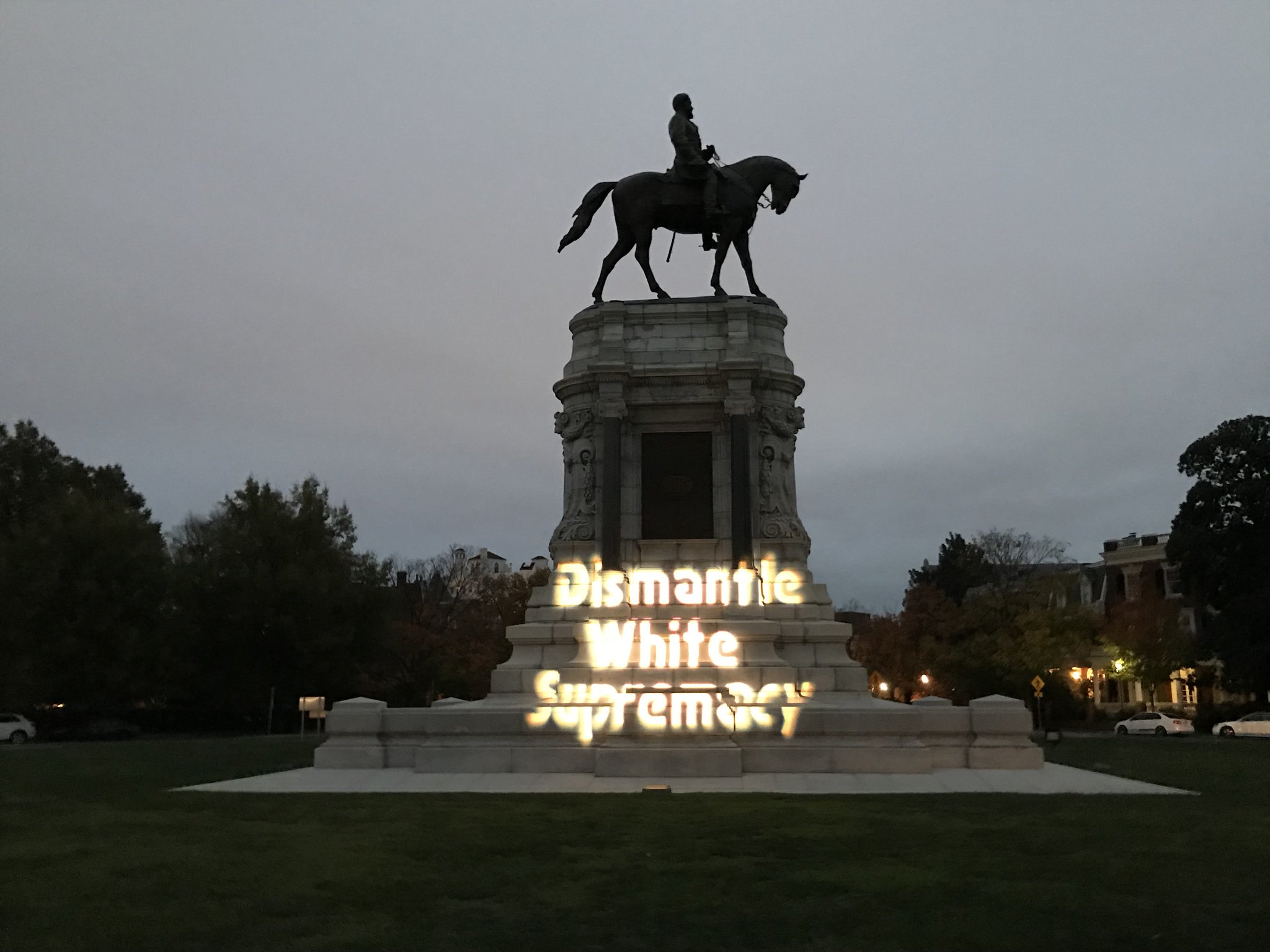 Protesters emblazoned Robert E. Lee statue with with guerrilla light projection messages, Dec. 7, 2017. (Richmond DSA, Flickr)