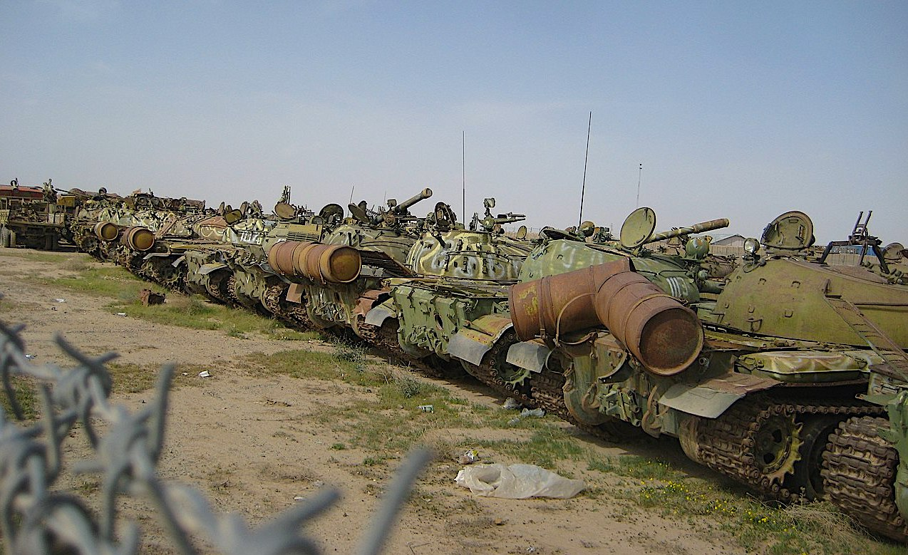 Abandoned Soviet T-54/55s lined up outside Kandahar Airfield in Afghanistan, April 2011. (Wikimedia Commons/Gregology)