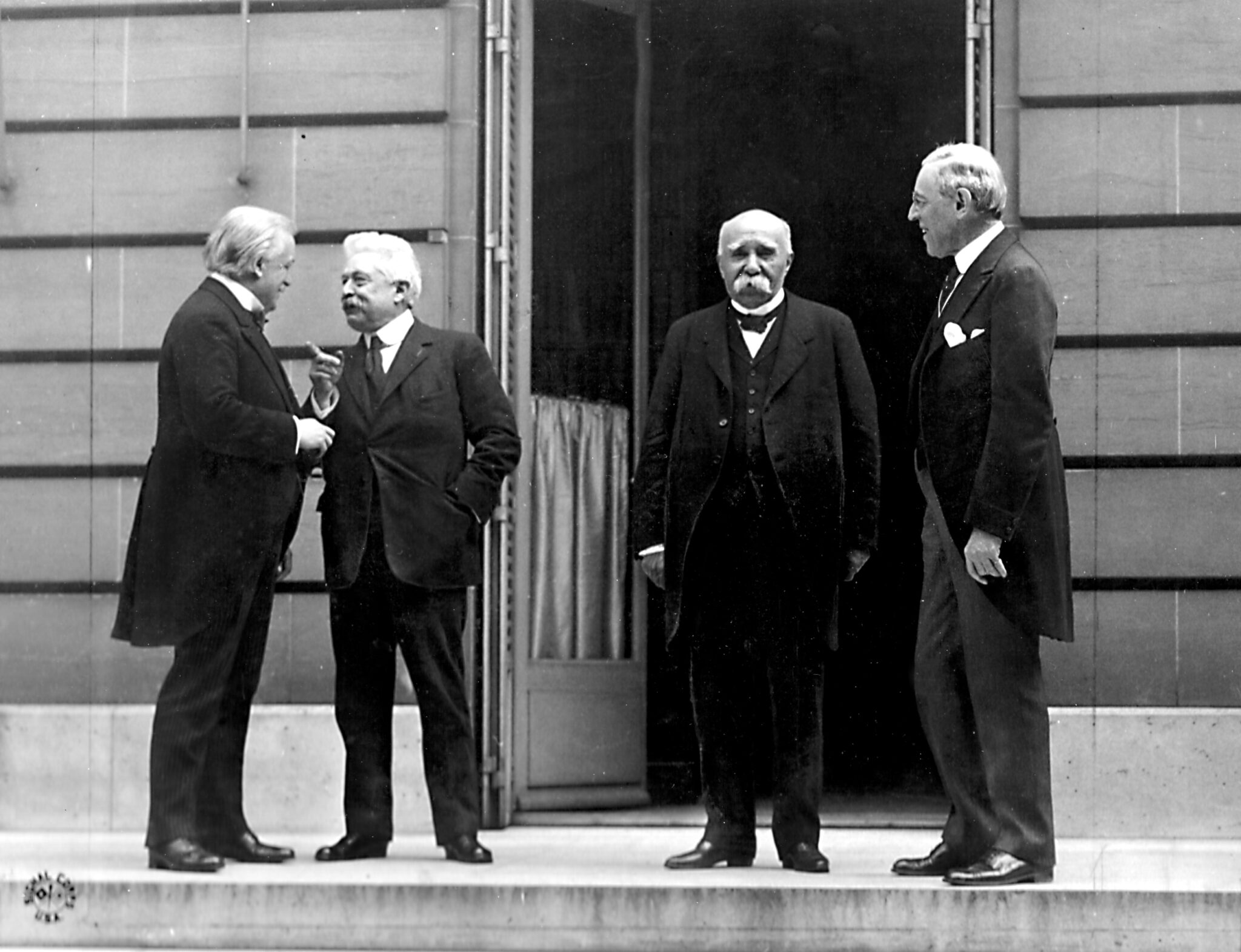 Council of Four at the WWI Paris peace conference, May 27, 1919: left to right, British Prime Minister David Lloyd George, Italian Premier Vittorio Orlando; French Premier Georges Clemenceau, U.S. President Woodrow Wilson. (Edward N. Jackson, U.S. Signal Corps, Wikimedia Commons)